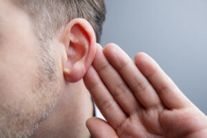 ear with hand